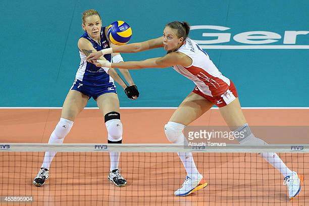 Alexandra Pasynkova and Svetlana Kryuchkova of Russia receive the ball against Belgium during the FIVB World Grand Prix Final group one match between...