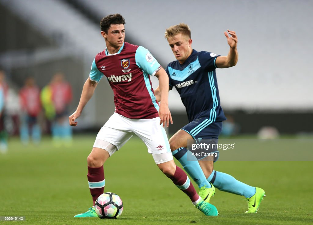 Alexandra Pattison of Middlesbrough chases down Joe Powell of West Ham United during the Premier League 2 match between West Ham United and Middlesbrough at London Stadium on April 10, 2017 in Stratford, England.