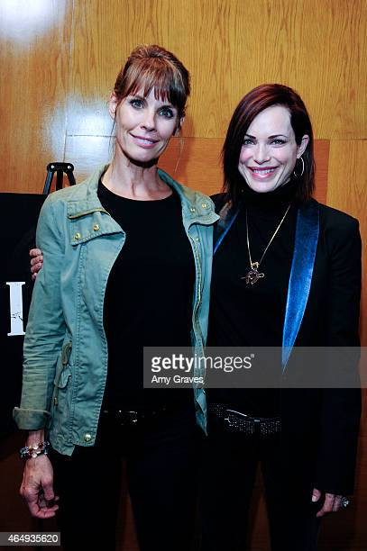 Alexandra Paul and Kristin Minter attend the Los Angeles Screening of 'Dirty' at Writers Guild Theater on March 1 2015 in Beverly Hills California