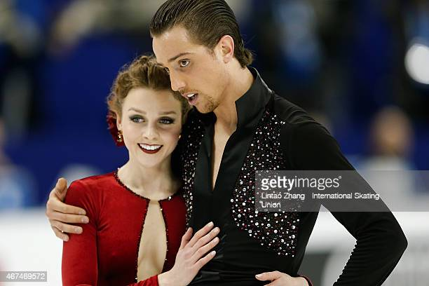Alexandra Paul and Mitchell Islam of Canada react after they compete in the Ice Dance Short Dance on day one of the 2015 ISU World Figure Skating...