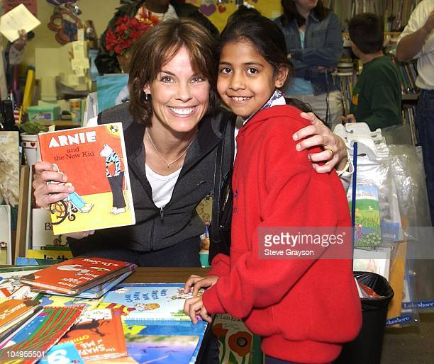 Alexandra Paul and Student during Celebrities Participate in the Read Across America Program at Mayo Elementary School in Compton California United...