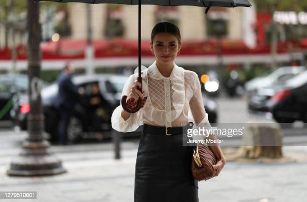 Alexandra Pereira seen wearing a complete Miu Miu look outside Miu Miu during Paris Fashion Week - Womenswear Spring Summer 2021 : Day Nine on...