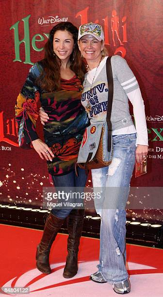 Alexandra Polzin and Claudia Effenberg pose for the media during the premiere of the movie 'Lilli The Witch The Dragon And The Magical Book' on...