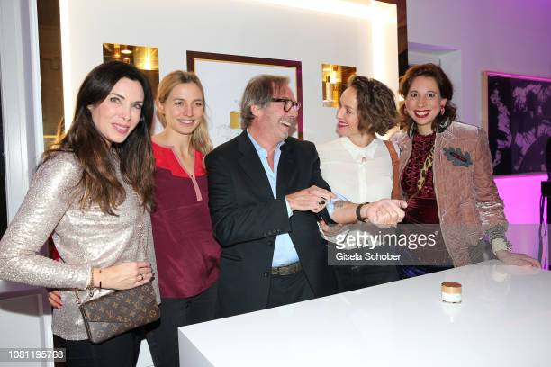 Alexandra Polzin Annika Blendl Didier Guillon founder and CEO Valmont Group and Valmont Foundation shows his Gorilla tattoo at his arm to Lara Joy...