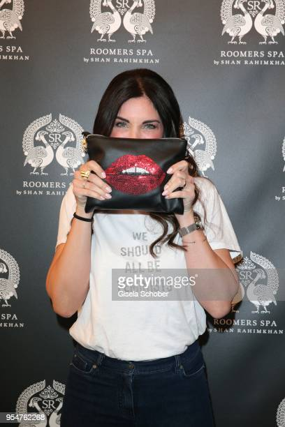 Alexandra Polzin with lips painted on a clutch during the Grand Opening of Roomers Spa by Shan Rahimkhan on May 4, 2018 in Munich, Germany.