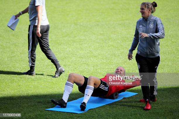 Alexandra Popp and Britta Carlson assistant coachr attend a Germany Women's training session at Stadion Essen on September 18 2020 in Essen Germany