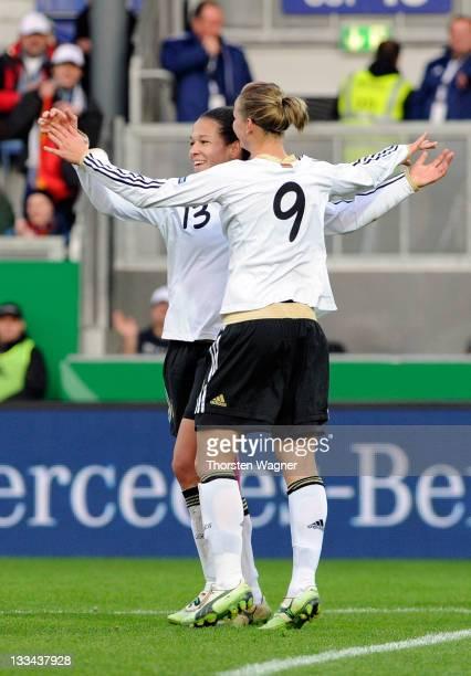 Alexandra Popp and Celia Okoyino da Mbabi celebrates during the Womens's Euro 2013 qualifier group 2 match between Germany and Kazakhstan at...