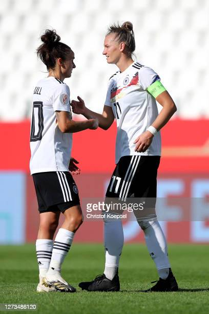 Alexandra Popp and Lina Magull of Germany celebrate after winning 30 the UEFA Women's EURO 2022 Qualifier match between Germany and Ireland at...