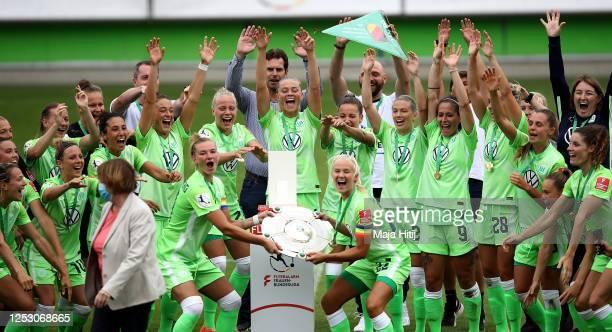 Alexandra Popp and Pernille Harder of Wolfsburg lift the trophy to celebrate the championship following the Flyeralarm Frauen Bundesliga match...