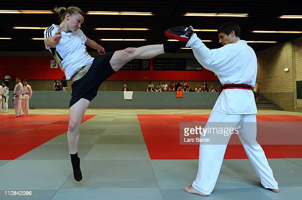 Alexandra Popp is doing a kick against a memeber assistant during a Taekwondo training session at the German Women National Team training camp at...