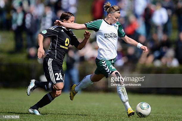 Alexandra Popp of Duisburg is chased by Sandra Smisek of Frankfurt during the Women's DFB Cup semi final match between 1 FFC Frankfurt and FCR...