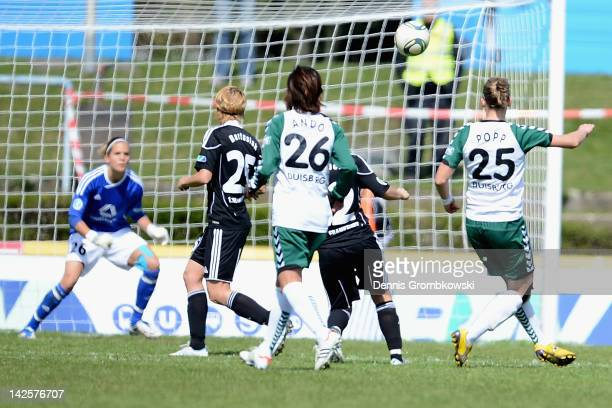 Alexandra Popp of Duisburg scores his team's second goal during the Women's DFB Cup semi final match between 1 FFC Frankfurt and FCR Duisburg at...