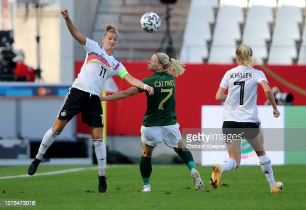 Alexandra Popp of Germany and Diane Caldwell of Ireland go up for a header during the UEFA Women's EURO 2022 Qualifier match between Germany and...