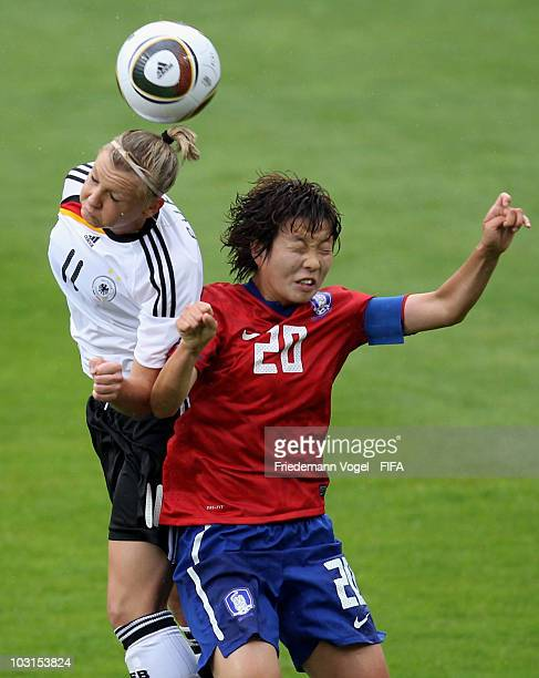 Alexandra Popp of Germany and Kim Hye Ri of South Korea battle for the ball during the FIFA U20 Women's World Cup Semi Final match between Germany...