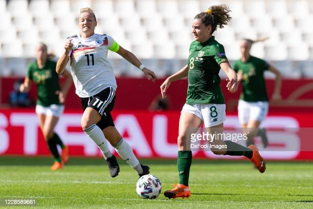 Alexandra Popp of Germany and Leanne Kiernan of Republik Irland battle for the ball during the UEFA Women's EURO 2022 Qualifier between Germany...
