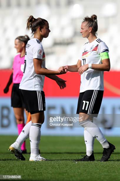 Alexandra Popp of Germany and Lena Oberdorf of Germany celebrate after winning 30 the UEFA Women's EURO 2022 Qualifier match between Germany and...