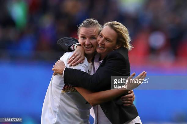 Alexandra Popp of Germany and Martina VossTecklenburg head coach of Germany celebrate following their sides victory in the 2019 FIFA Women's World...