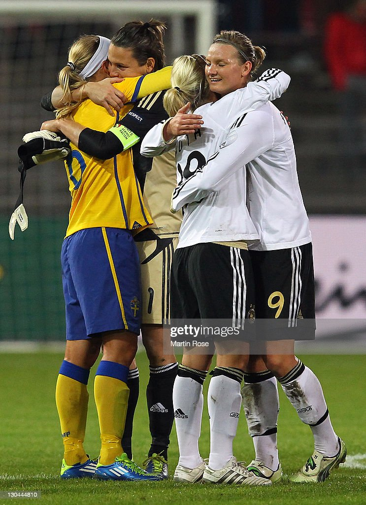Alexandra Popp (#9) of Germany celebrate with team mate Svenja Huth after the Women's International friendly match between Germany and Sweden on October 26, 2011 in Hamburg, Germany.