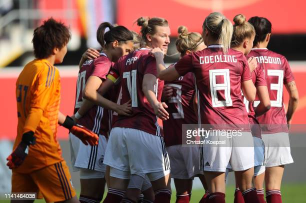 Alexandra Popp of Germany celebrates after scoring her team's first goal with team mates during the Women's International Friendly between Germany...