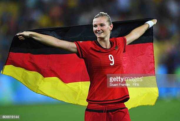 Alexandra Popp of Germany celebrates after winning the Olympic Women's Football final between Sweden and Germany at Maracana Stadium on August 19...