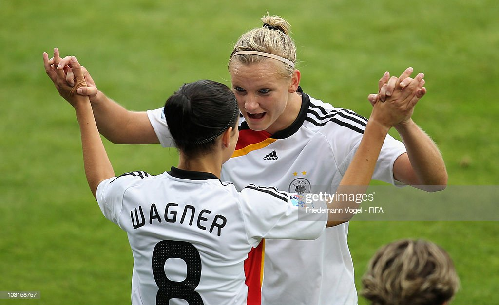Alexandra Popp (R) of Germany celebrates during the replacement with Selina Wagner (L) during the FIFA U20 Women's World Cup Semi Final match between Germany and South Korea at the FIFA U-20 Women's World Cup stadium on July 29, 2010 in Bochum, Germany.