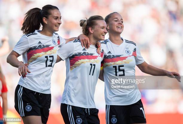 Alexandra Popp of Germany celebrates her team's first goal with teammates Sara Daebritz and Giulia Gwinn during the international friendly match...