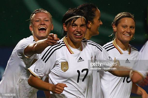 Alexandra Popp of Germany celebrates scoring the 3rd team goal with her team mates Ariane Hingst 2nd L and Martina Mueller during the women's...