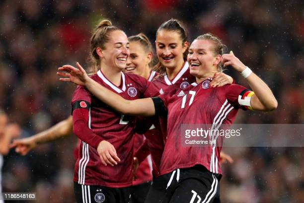 Alexandra Popp of Germany celebrates scoring the opening goal during the International Friendly between England Women and Germany Women at Wembley...