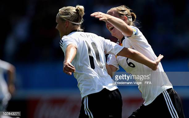 Alexandra Popp of Germany celebrates scoring the second goal with Marina Hegering during the FIFA U20 Women's World Cup Group A match between Germany...