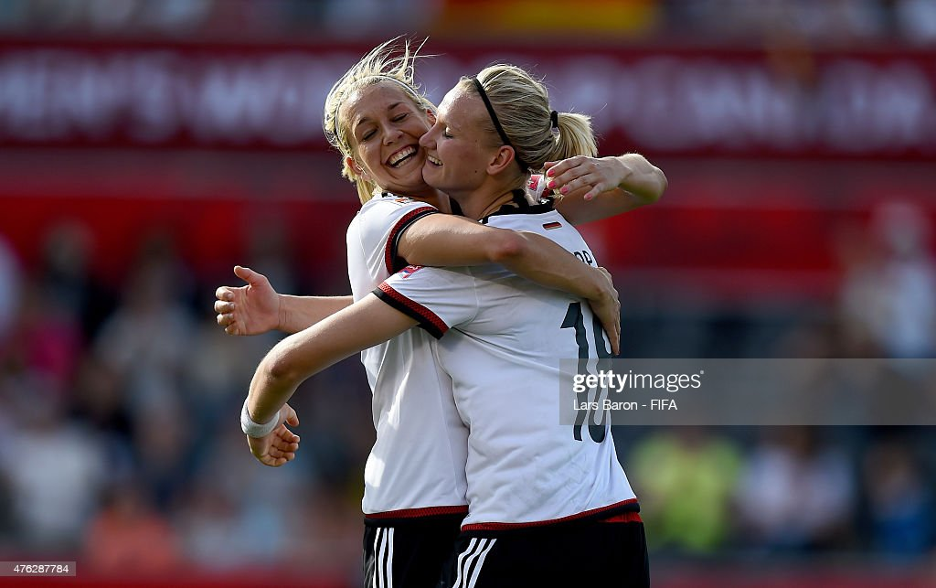 Alexandra Popp of Germany celebrates with Lena Goessling of Germany after scoring her teams tenth goal during the FIFA Women's World Cup 2015 Group B match between Germany and Cote D'Ivoire at Lansdowne Stadium on June 7, 2015 in Ottawa, Canada.
