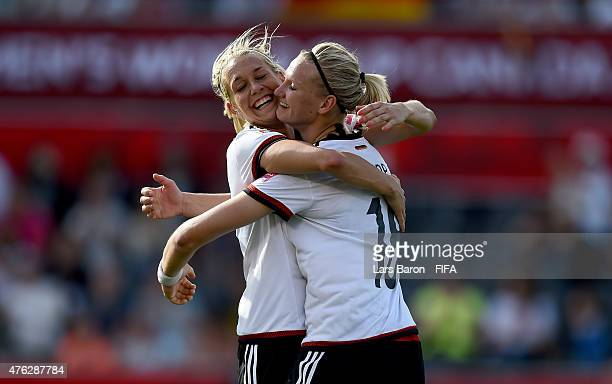 Alexandra Popp of Germany celebrates with Lena Goessling of Germany after scoring her teams tenth goal during the FIFA Women's World Cup 2015 Group B...