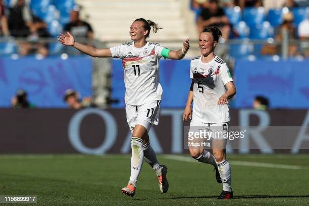 Alexandra Popp of Germany celebrates with Marina Hegering after scoring her team's second goal during the 2019 FIFA Women's World Cup France group B...