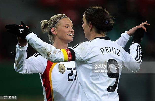 Alexandra Popp of Germany celebrates with team mate Birgit Prinz during the women's international friendly match between Germnay and Nigeria at...