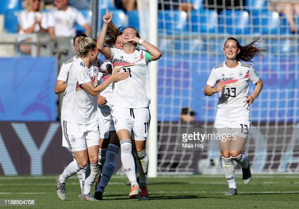Alexandra Popp of Germany celebrates with teammates after scoring her team's third goal during the 2019 FIFA Women's World Cup France group B match...