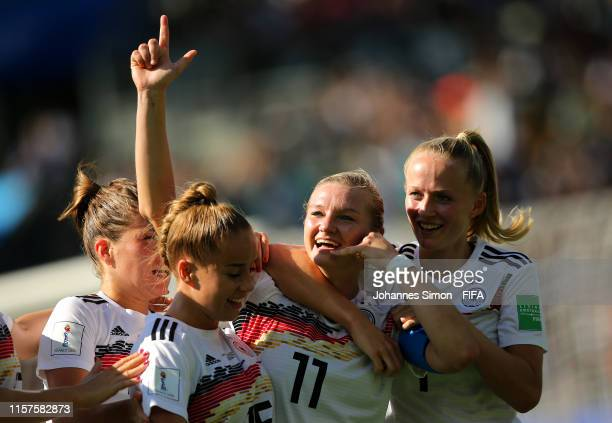 Alexandra Popp of Germany celebrates with teammates after scoring her team's first goal during the 2019 FIFA Women's World Cup France Round Of 16...