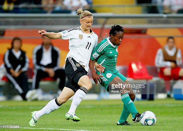 Alexandra Popp of Germany challenges Stella Mbachu of Nigeria during the FIFA Women's World Cup 2011 Group A match between Germany and Nigeria at...