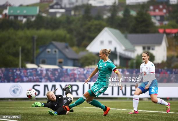 Alexandra Popp of Germany has an attempt at goal blocked by Anna Hansen of Faeroe Islands the Faeroe Islands Women's v Germany Women's 2019 FIFA...
