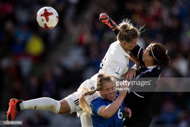 Alexandra Popp of Germany Ingibjoerg Sigurdardottir and Gudbjoerg Gunnarsdottir of Iceland battle for the ball during the Iceland Women's and Germany...