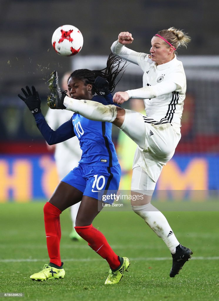 Alexandra Popp of Germany is challenged by Aminata Diallo of France during the Germany v France Women's International Friendly match at Schueco Arena on November 24, 2017 in Bielefeld, Germany.