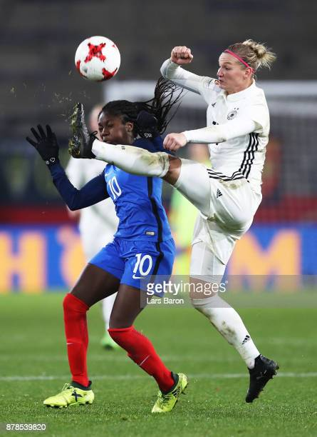 Alexandra Popp of Germany is challenged by Aminata Diallo of France during the Germany v France Women's International Friendly match at Schueco Arena...