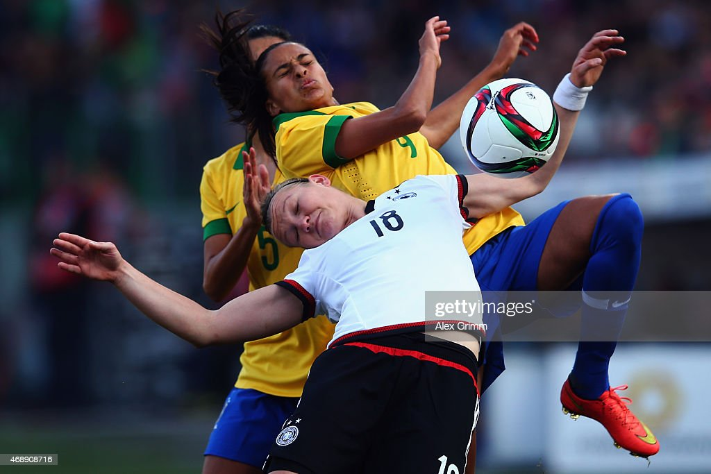 Alexandra Popp (front) of Germany is challenged by Andressa Alves of Brazil during the Women's International Friendly match between Germany and Brazil at Trolli-Arena on April 8, 2015 in Fuerth, Germany.