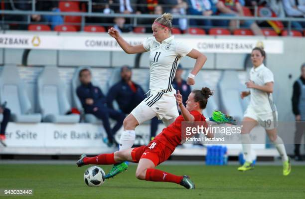 Alexandra Popp of Germany is challenged by Jana Sedlackova of Czech Republic during the 2019 FIFA Womens World Championship Qualifier match between...