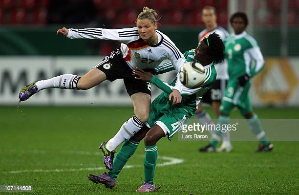 Alexandra Popp of Germany is challenged by Perpetua Nkwocha of Nigeria during the women's international friendly match between Germnay and Nigeria at...