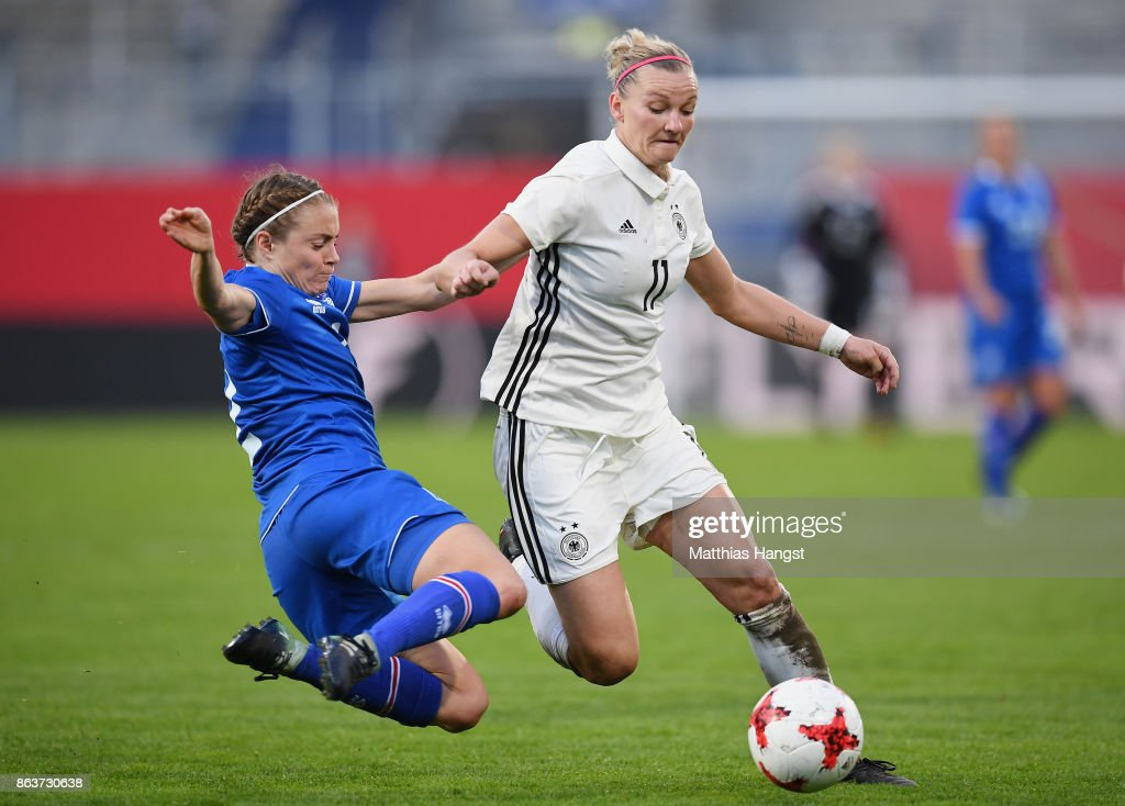 Alexandra Popp of Germany is challenged by Sif Atladottir of Iceland during the 2019 FIFA Women's World Championship Qualifier match between Germany and Iceland at BRITA-Arena on October 20, 2017 in Wiesbaden, Germany.