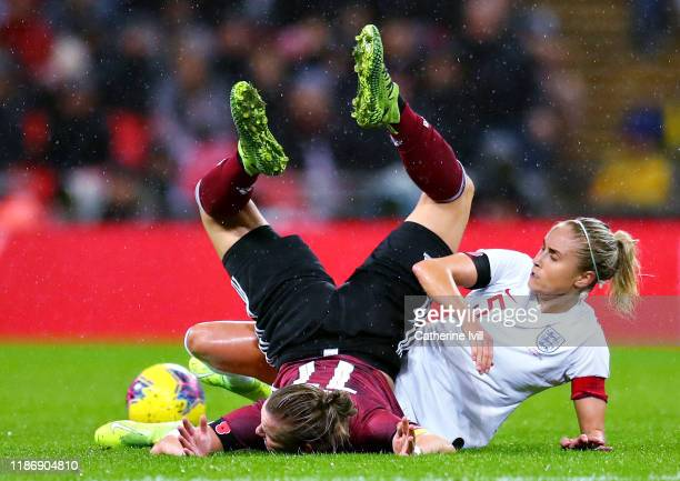 Alexandra Popp of Germany is challenged by Steph Houghton of England during the International Friendly between England Women and Germany Women at...