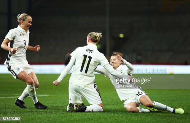 Alexandra Popp of Germany is congratulated by Linda Dallmann after scoring the first goal during the Germany v France Women's International Friendly...