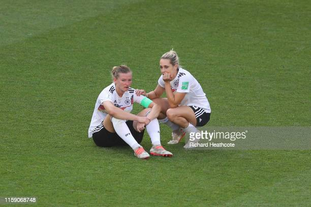 Alexandra Popp of Germany is consulted by teammate Lena Goessling of Germany at fulltime after the 2019 FIFA Women's World Cup France Quarter Final...