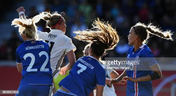 Alexandra Popp of Germany jumps for a header with Sara Bjoerk Gunnarsdottir of Iceland and Rakel Hoennudottir of Iceland during the 2019 FIFA Women's...