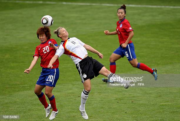 Alexandra Popp of Germany Kim Hye Ri and Jeong Yeonga of South Korea battle for the ball during the FIFA U20 Women's World Cup Semi Final match...
