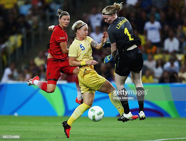 Alexandra Popp of Germany Nilla Fischer of Sweden and Hedvig Lindahl of Sweden clash for the ball during the Women's Olympic Gold Medal match between...